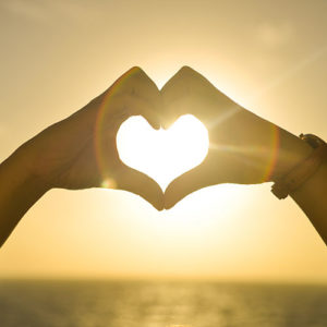 Image of hands making heart shape for holistic health speaking engagements at nutritionbliss.com